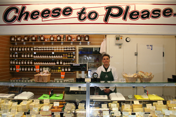 Behind the Cheese counter at Cheese to Please